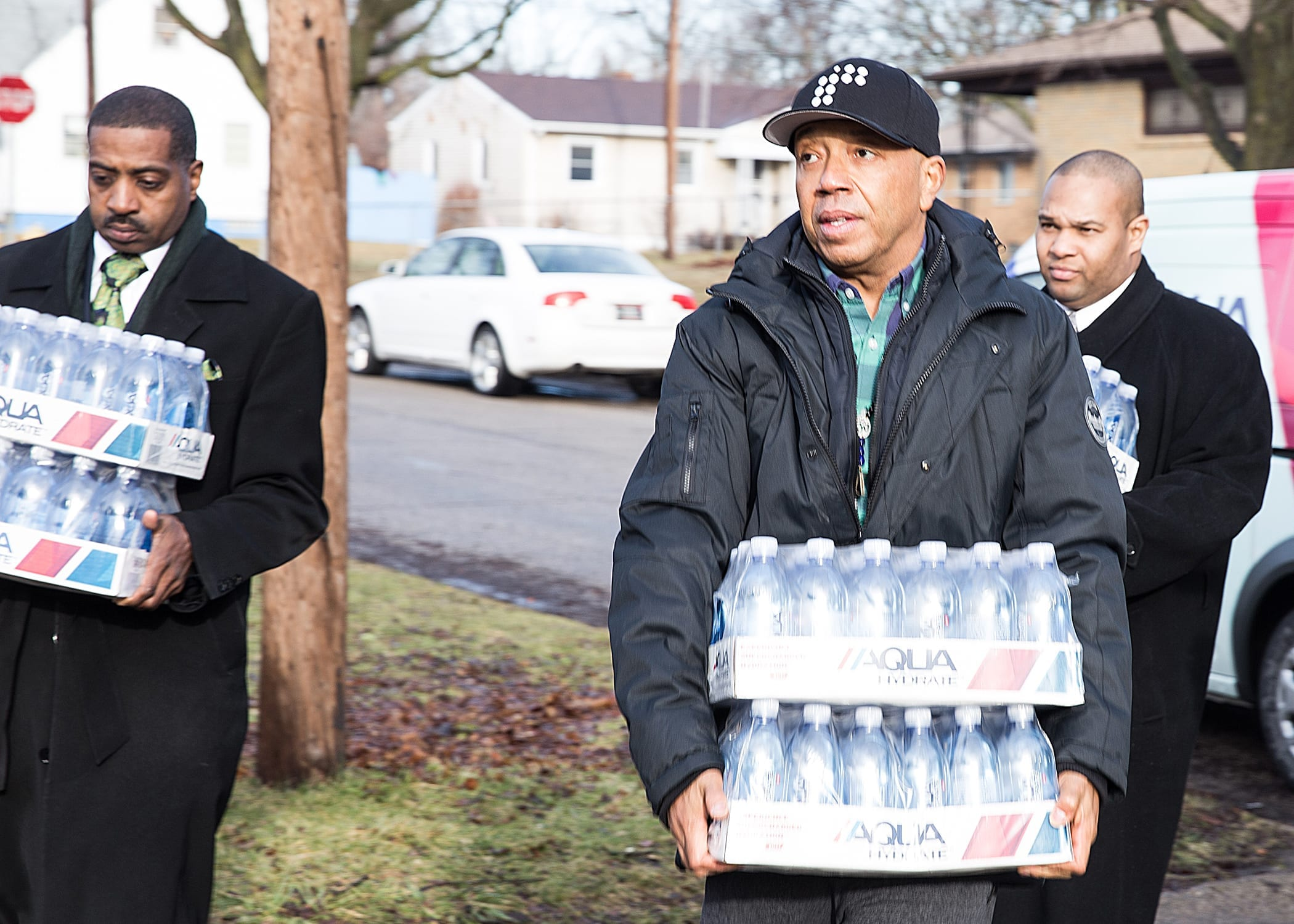 Russell Simmons delivers water to victims of Flint water crisis. (Kory Woods/Michigan Chronicle/NNPA)