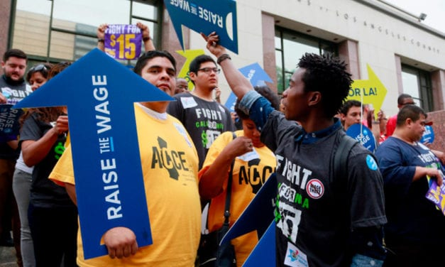 Minimum-wage workers will see pay boosts on Jan. 1
