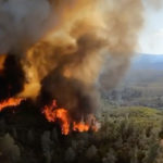 Helicopters Pull More People from Burning California Forest